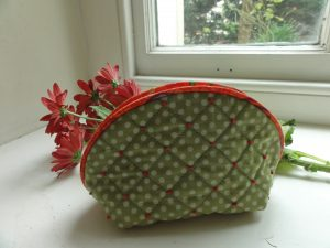 Embroidered quilted pouch