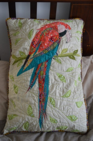 Quilted machine embroidered parrot cushion
